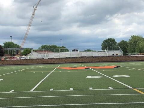 The bleachers were re-installed on the east side of the stadium and site concrete  was completed.
