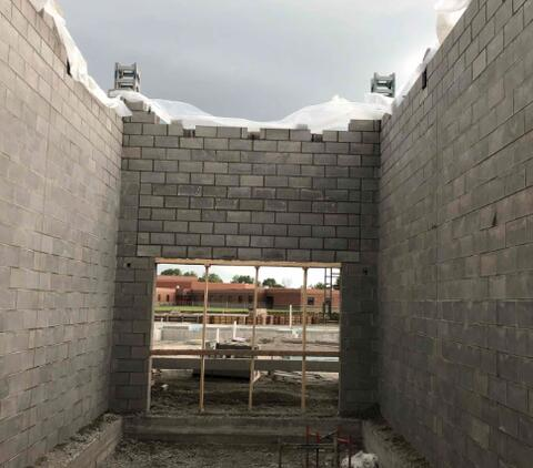 The masonry for the stairwell on the north side of Area A in in progress. The elevator shaft will soon follow.