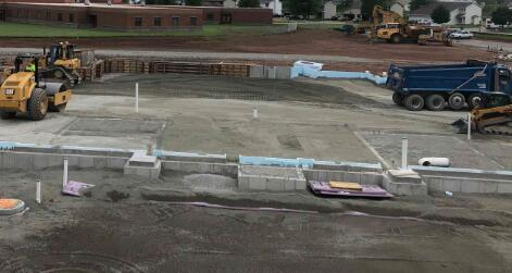 Area B is being brought up to grade with structural fill and compacted to provide support for the floor slab in the future.
