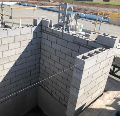 The masonry elevator shaft is being built up as well as the foundation walls for the learning staircase.