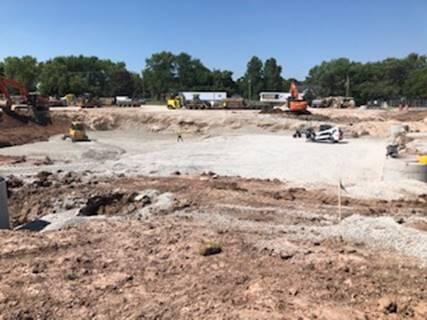 Excavation on the north parking lot continued and the stormtech system is starting to be placed.