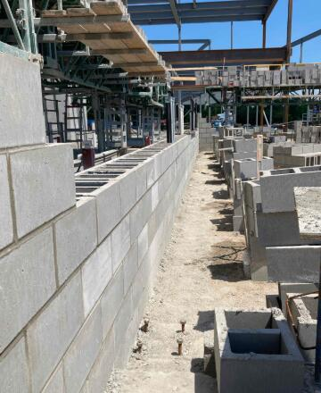 Masonry walls in the music wing are being built. This is being done in conjunction with the electrical and plumbing contractors.