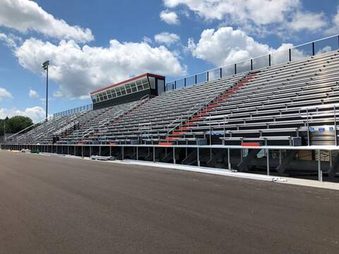 At the stadium, the bleachers are near completion.
