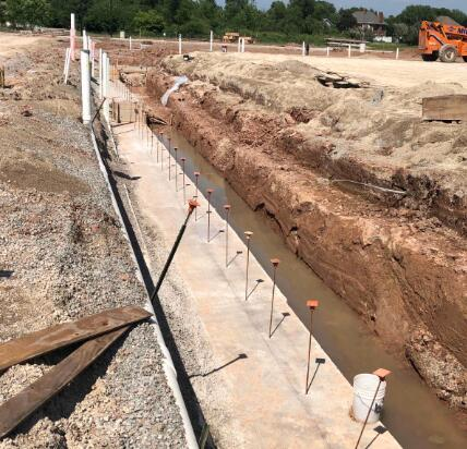 Footings for the West side of the gym have been poured.