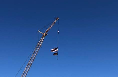 Crane at the high school flying the American flag.