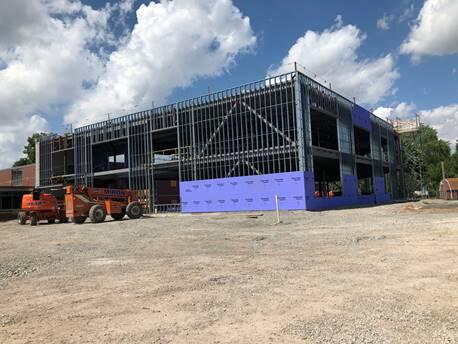 Exterior sheathing is starting to go up for the classroom addition. Next up will be exterior brick, windows, and roofing!