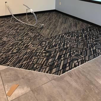 Carpet was installed today in the remote office, giving the space a final finished look.