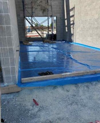 The concrete slab within the stairwell in area A has been poured and is now curing.