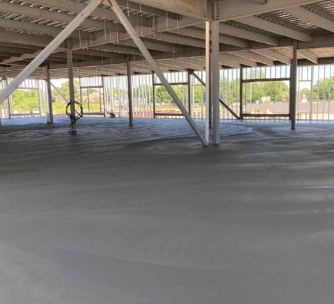 Part of the 1st floor concrete slab has been poured. This slab will also be wet cured.