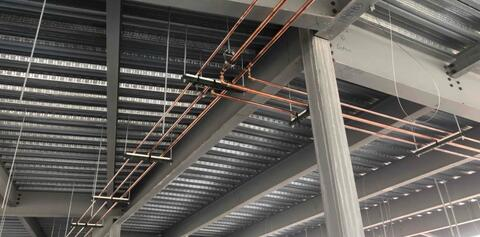 Installation of the above ceiling plumbing lines has begun in area A.