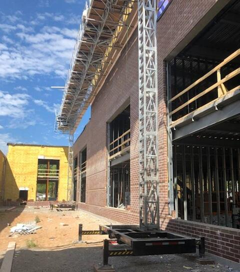 Exterior brick is now being placed in the court yard of the two story classroom addition.