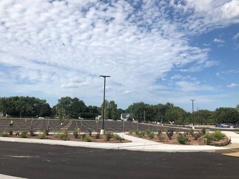 The north parking lot is looking more finished as the days go on. Landscaping is now going in!