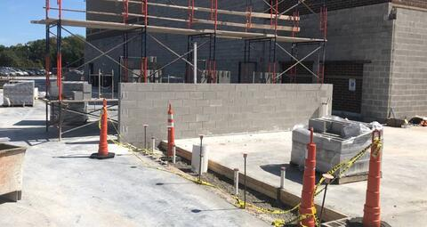 The masonry walls in the new athletic addition have begun.