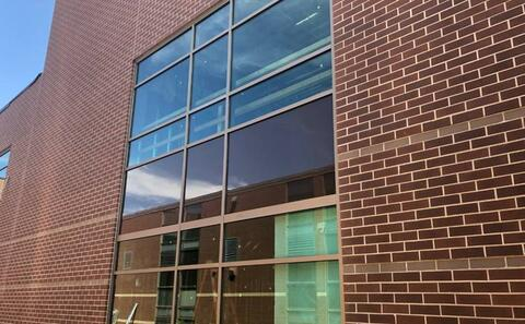 Glass and trim for the new windows in the courtyard have been installed.