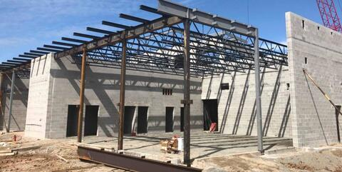The steel columns, beams, and joists have been installed above the band and music room.