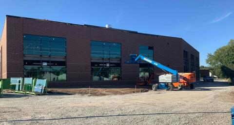 New glass is being installed around the new addition.