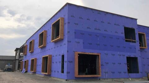 The exterior sheathing is starting to wrap around area A.  In the next few weeks, this purple sheathing will be covered in spray foam insulation.