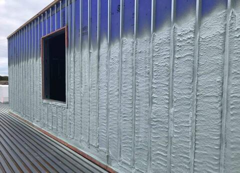 Spray foam insulation has begun around the exterior of the building.  The penthouse shown in this picture will be covered next with plywood and finished with dark gray metal panels.