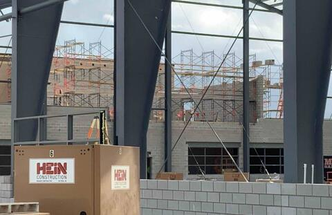 The block walls at the second floor of the athletic addition are being constructed.