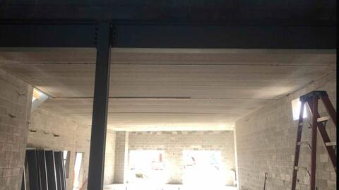 The precast planks above the kitchen have been installed.  Located directly above the kitchen is a mechanical mezzanine.