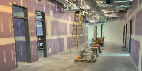 On the first floor of the new classroom addition, the drywall is being finished and will be ready for paint soon.