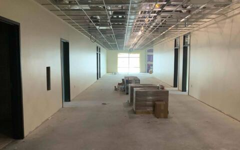The drywall is complete on the second floor of the new classroom addition and the ceiling grid has been installed.
