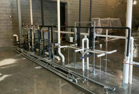 Plumbing for the new restrooms in the athletic addition is being installed.