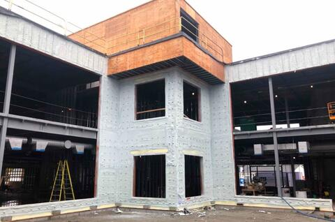 The spray foam insulation is in place in the courtyard.  In the next few weeks, these walls will have facebrick installed.