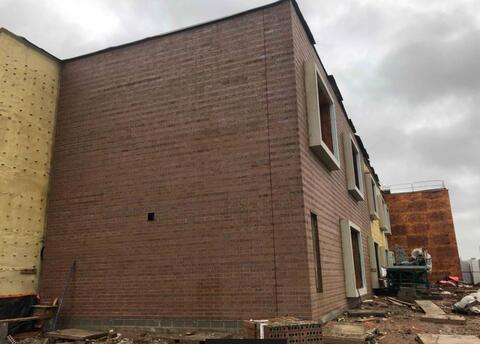 Facebrick is installed at the northwest corner of the school and is continuing along the west wall facing 9th Street.