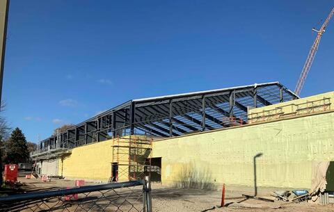 Additional spray foam insulation has been applied to the exterior west wall of the athletic facility.  Prep work on the metal building and roof has also taken place so the exterior metal panel installation can soon begin.