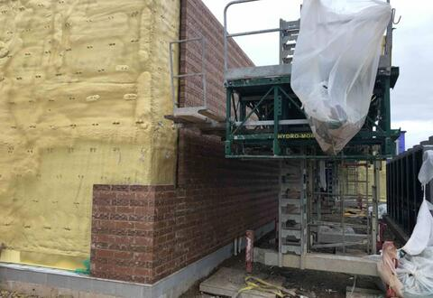 Brick along the north side of area D is nearly complete.  With this installed, the permanent gas meter can be installed to heat the building during the winter months.