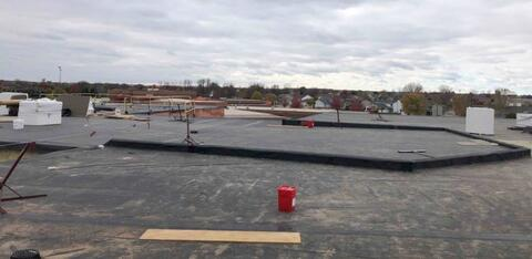 The roofing above the library is complete and is working towards the gym and cafeteria.
