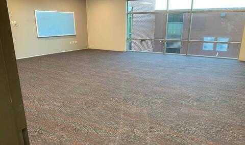Carpet is being installed on the second floor of the new classroom addition. First floor is not far behind.