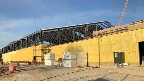Exterior spray foam insulation is almost complete for the athletic facility addition. Crews also began the metal panel install on the roof, and wall panels will soon follow.