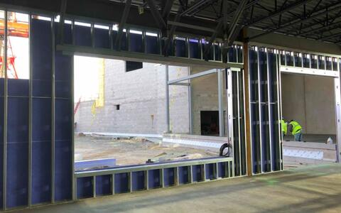 The exterior framing and sheathing is continuing to wrap around the building and is making it's way into the cafeteria.