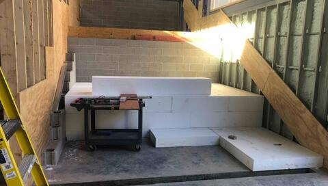 Pictured here is geofoam that is being installed under the learning stairs.  This foam will help support the lower half of the stairs.