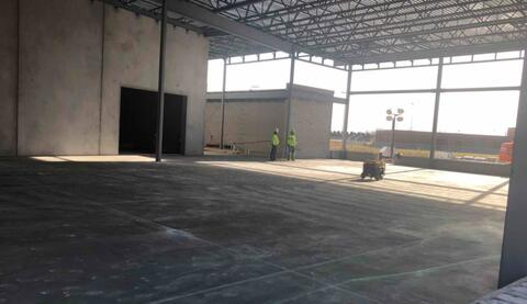 The concrete floor in the cafeteria was poured earlier this week.  All the concrete floors for the whole building are now complete.