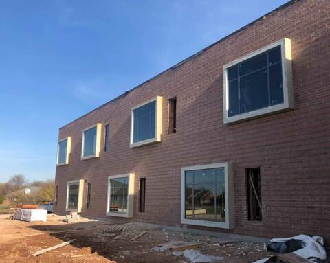 The large windows on the west side of the classroom area have been installed.  From inside the classrooms, these bumped out windows will provide students with a nice place to sit.