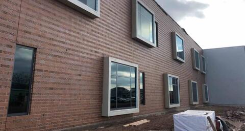 On the west side of the building the brick has been washed and is looking sharp.
