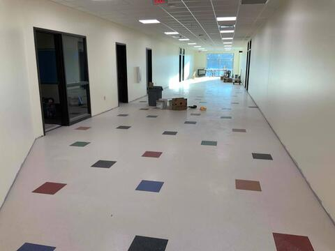 Ceiling tile finished and the hallway flooring was installed this week on second floor of the classroom addition. Wall base is next, then this level is just about complete!