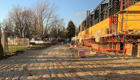 Masons have started to install the exterior brick on the west side of the athletic facility addition.