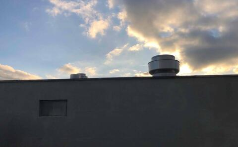 Exhaust fans have been installed on top of both penthouses and above the mechanical mezzanine.