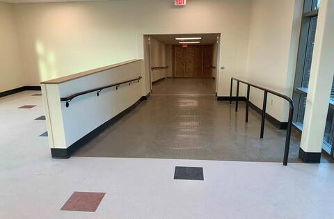 One of the ramps that connects the existing school to the new classroom addition on second floor is just about complete. This includes handrails, painting, flooring and wall base. Don't worry, the wood partition at the end of the connecting link will soon be removed!
