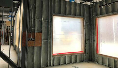 The spray foam insulation on the inside of the walls is complete on all the first and second floor classrooms.