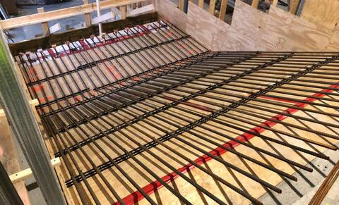 The rebar for the top half of the learning stairs is being installed.  After all the concrete stairs are fully poured and cured, the plywood below will be removed and the space under the stairs will be used for storage.