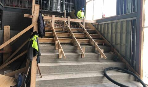 The learning stairs have been poured up to the landing at the midway point in stairs.