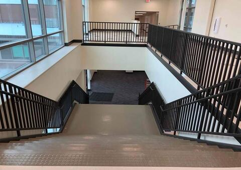 Flooring is complete on the stairs of the classroom addition.
