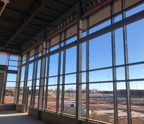 The framing for the windows in the cafeteria have been installed with glass following shortly after.