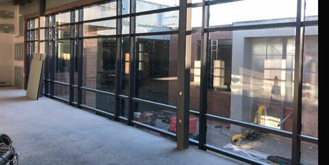 The glass has been installed in the curtainwalls looking out to the courtyard.  These glass walls help fill the hallways with natural light.