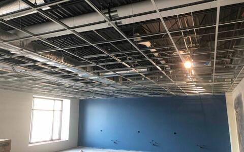 The ceiling grid installation has started in the second floor classrooms.